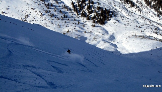 Skiing down Mount Cherna Mogila in Pirin Mountains