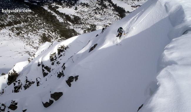 Skiing down Mount Todorka in Pirin Mountains