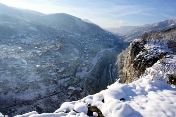 Iskar Gorge in snow and the village of Lakatnik