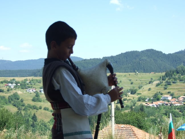 Young bagpipe player in Gela