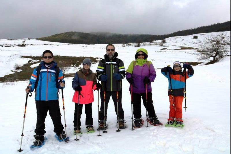 Family snowshoeing Rila